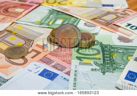 euro banknote with coins 5 10 50 100