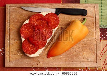 Salami sandwich - cutting board - breakfast