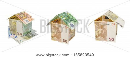 house made from dollar bills with key isolated on white background