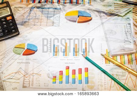 finance report with glasses calculator and pen