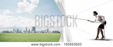 Businesswoman pulling white blank fabric. Place for text