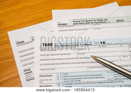 1040 tax form with pen on desk