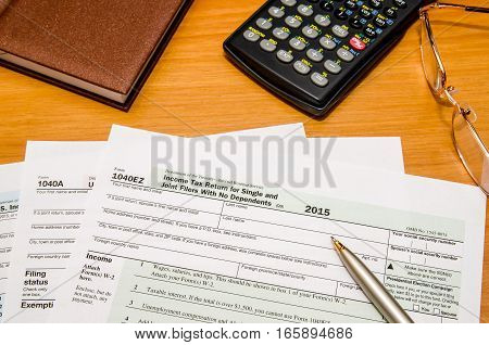 tax form 1040 for 2016 year with calculator