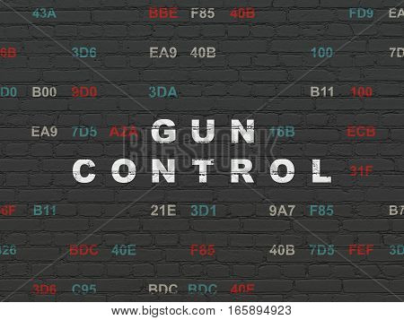 Security concept: Painted white text Gun Control on Black Brick wall background with Hexadecimal Code