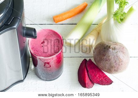 Juicer, red beetroot juice, other vegetables health diet detoxification concept