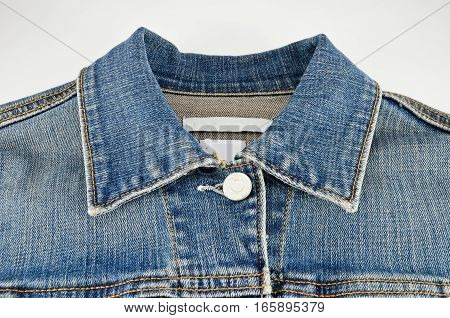 Jeans shirt collar closeup isolated on white background