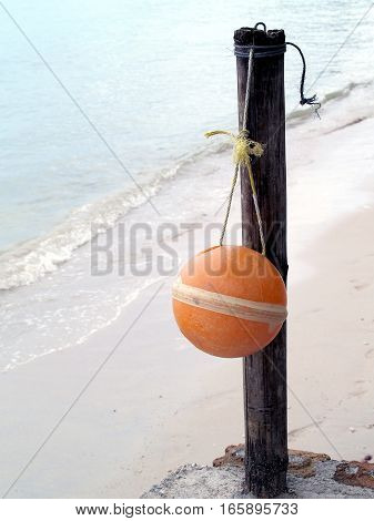 orange buoy hanging on the pole, tools for fishing