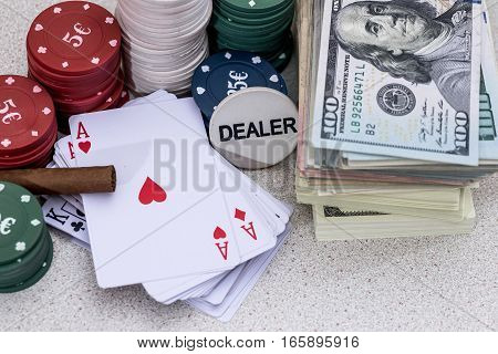 poker chips and play card with sigar and money