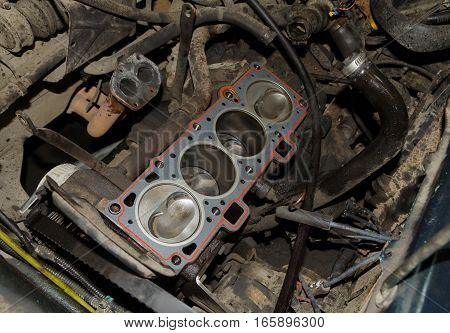 real used opened car engine under repair