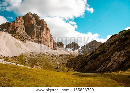 Dolomites lake Mitteralplsee and mountains, South Tyrol, Italy