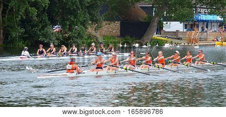 ST NEOTS, CAMBRIDGESHIRE, ENGLAND - JULY 24, 2016: Ladies coxed eights rowing in competition on the river ouse at St Neots