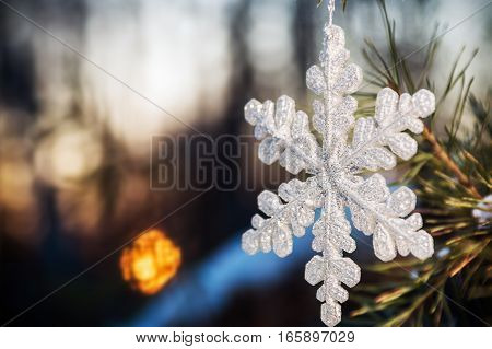 snowflake snowy forest at sunset. Christmas decorations. soft focus