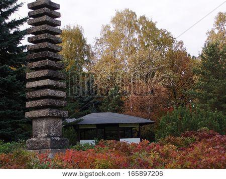 The entrance of a beautiful japanese garden at autumn season.
