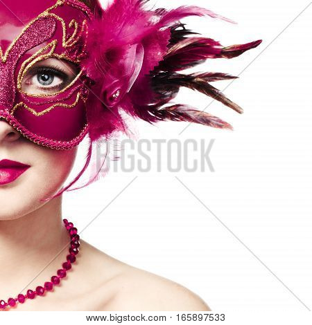 Beautiful young woman in mysterious golden Venetian mask. Fashion photo