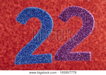 Number twenty-two blue purple over a red background. Anniversary. Horizontal