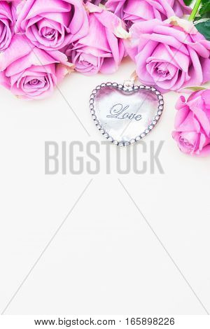 Valentines day violet roses top view flat lay scene with heart and copy space