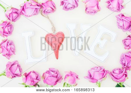 Valentines day violet roses with love letters top view flat lay frame