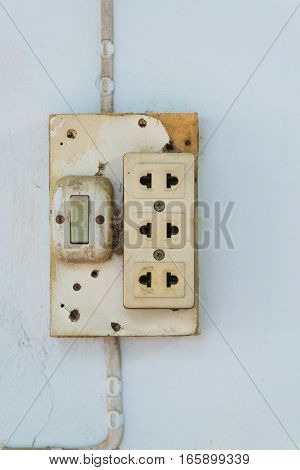 Close-up of old socket electrical outlet wall socket or outlet plate on the wall