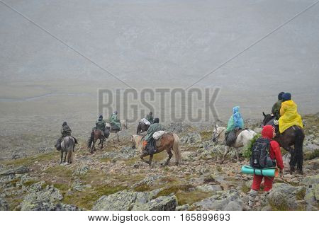 Aug 18 2012 - a Group of tourists on horseback go through the Sayan mountains. Equestrian expedition. Aug 18 2012.