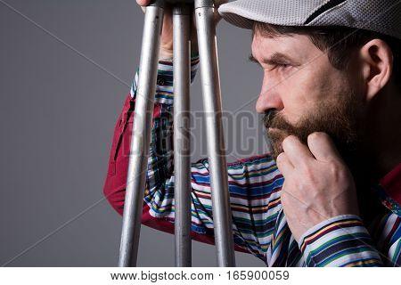 Man With Beard A Tripod Thoughtfully