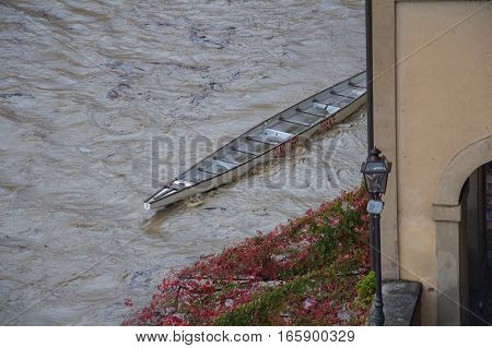 Italy Florence - November 06 2016: view of canoe and Arno river after heavy rain on November 06 2015 in Florence Italy.