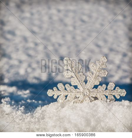 Christmas snowflakes on a snowy background. Christmas decorations