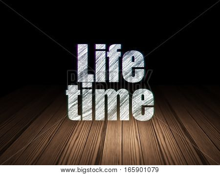 Timeline concept: Glowing text Life Time in grunge dark room with Wooden Floor, black background