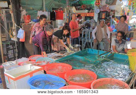 HONG KONG - NOVEMBER 7, 2016: Unidentified people sell fish at Tai O village market Lantau island.