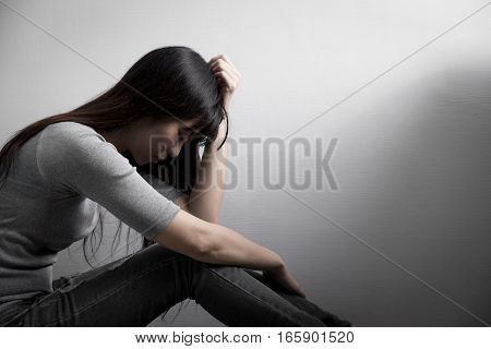 The depression woman sit on the floor