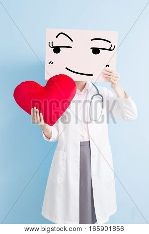 woman doctor take look somewhere billboard and heart isolated on blue backgorund asian