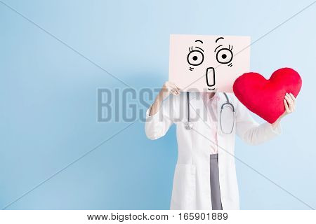 woman doctor take surprise billboard and heart isolated on blue backgorund asian