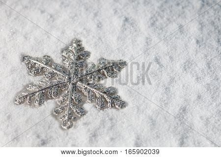 Christmas snowflake on snow background. Christmas decorations