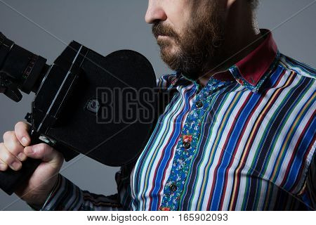 Bearded Man Movie Camera Thoughtfully Looks