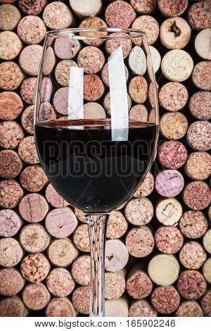 wine corks through a glass of red wine. Focus on the glass