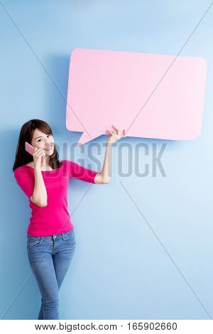 beauty woman take speech bubble billboard and talk on phone