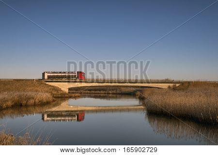 Tanker truck on bridge over Ribe River in Denmark.