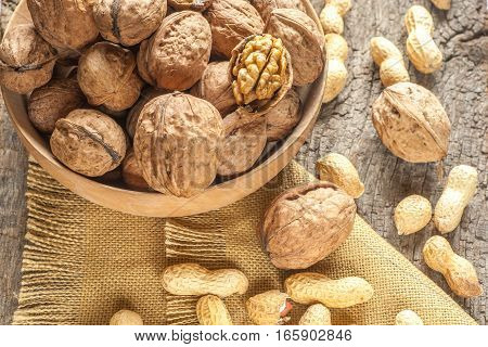 Nuts mix in a wooden plate (organic food)