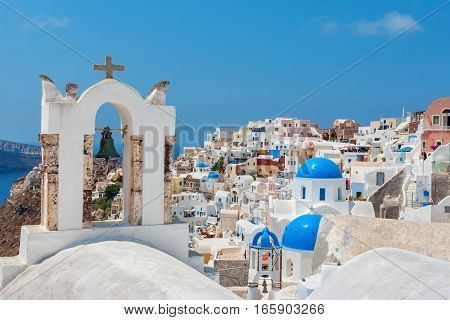 Bell tower and Oia village. Santorini island Cyclades Greece