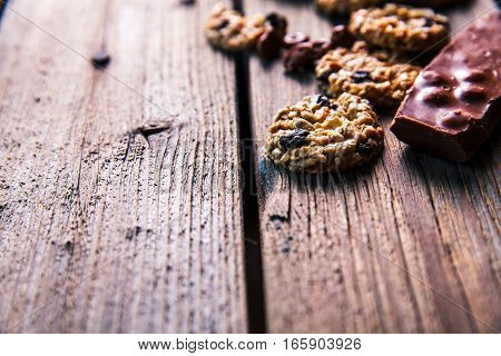 Set of sweets. Chocolate bars and granola on a wooden background with milk chocolates. Food, candy, snack