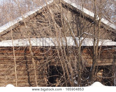 The old wooden abandoned house in the village