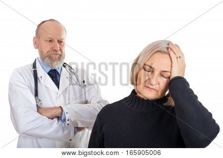 Picture of an elderly woman having a migraine standing with her doctor