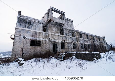 Abandoned settlement with decayed buildings in Kolyma winter view poster