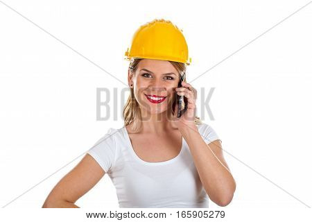 Picture of a smiling female engineer talking on the phone