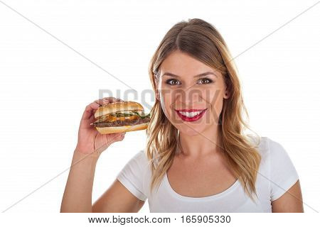 Picture of a smiling young woman holding a tasty hamburger