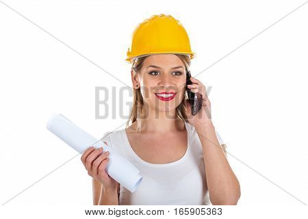 Portrait of a beautiful female engineer talking on the phone