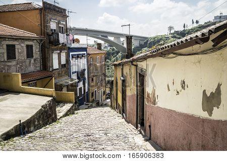 Narrow street with a view on Ponte do Infante, Porto, Portugal