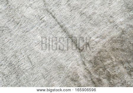 Closeup surface at stone pattern at stone brick wall in the garden textured background