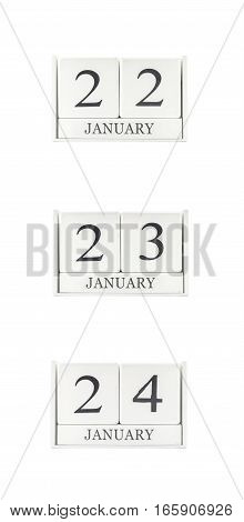 Closeup group of white wooden calendar with black 22 23 24 january word three date calendar isolated on white background