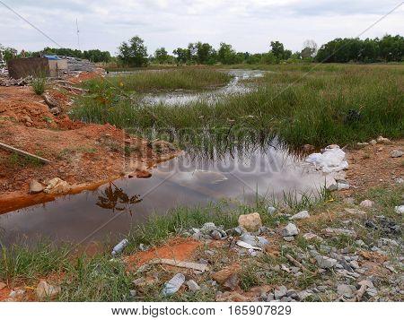30 december 2016 otres beach sihanoukville cambodia waste garbage at a lake editorial image