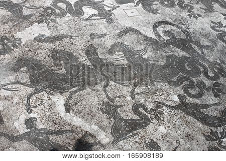 Ancient roma mosaic in Ostia Antica the old harbour of Rome, Italy